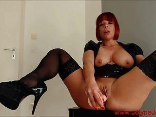 Mature redhead masturbating with red dildo
