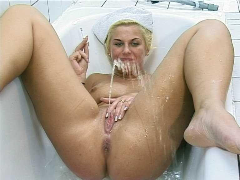 Girl peeing the there own mouth